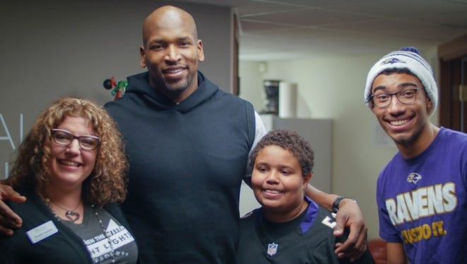Baltimore Ravens lineman Eugene Monroe  (second from left) is the first active NFL player to call on the league to remove marijuana from its list of banned substances.