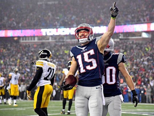 New England Patriots wide receiver Chris Hogan (15) celebrates after scoring a touchdown during the first quarter against the Pittsburgh Steelers in the 2017 AFC Championship Game at Gillette Stadium. Mandatory.