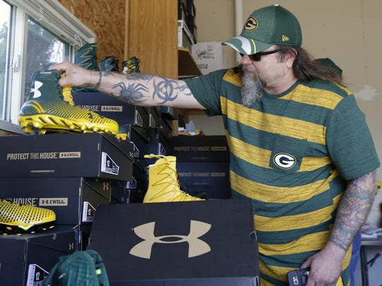 A.J. Grill of Green Bay looks at shoes for sale during former Green Bay Packer Eddie Lacy's garage sale held May 5, 2017 at his De Pere residence. Lacy is moving out of the area to join the Seattle Seahawks for the 2017 season.  Sarah Kloepping/USA TODAY NETWORK-Wisconsin