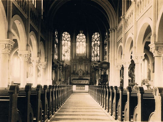 Historical photo of the interior nave of the Cathedral of Saint John the Evangelist in the 1920s.