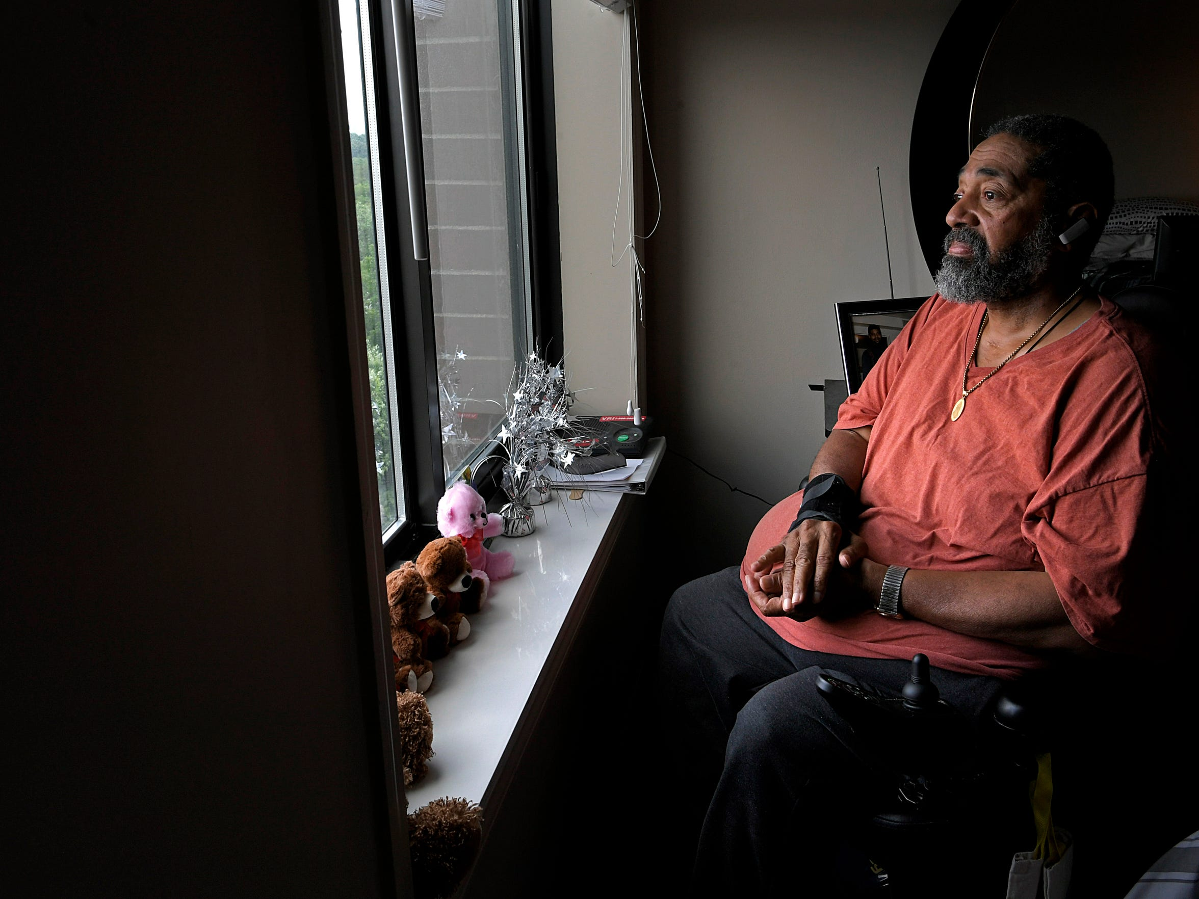 Ernest Porter looks out the window of his senior living high-rise apartment in downtown Nashville on Friday, July 20, 2018. It is a significant upgrade from his prior living conditions — and an important move for Porter's mental health.