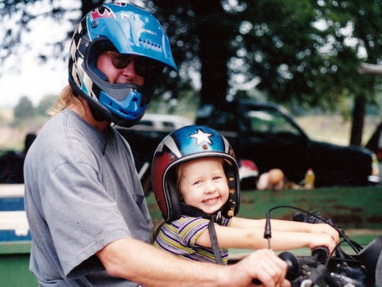 Jathan Fields left a legacy with two sons and a daddy's girl, Alison, who is shown here enjoying a motorcycle ride.