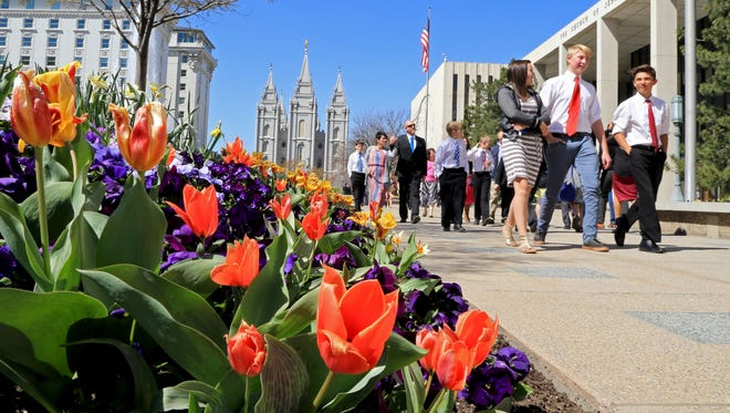 Latter-day Saints leave Temple Square in Salt Lake City on Saturday following the morning session of their faith's 186th Annual General Conference.