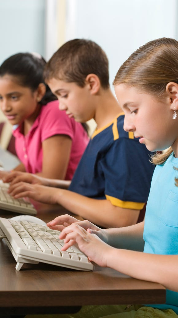 Children working on computers