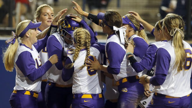 LSU celebrates a run by Bianka Bell (27) during an NCAA Women's College World Series game against Alabama in Oklahoma City, Saturday, May 30, 2015.