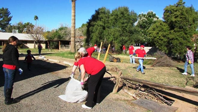 Volunteers from a Scottsdale church spruce up a property in December 2013.