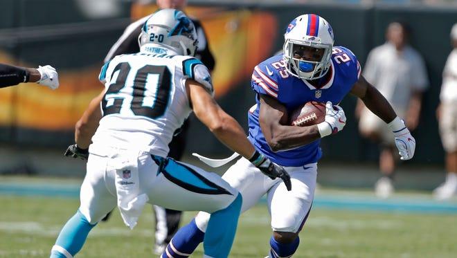 Buffalo Bills' LeSean McCoy (25) runs as Carolina Panthers' Kurt Coleman (20) defends in the second half of an NFL football game in Charlotte, N.C., Sunday, Sept. 17, 2017. (AP Photo/Bob Leverone)