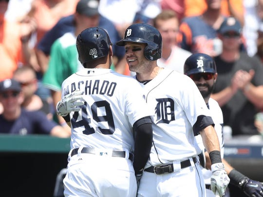 Dixon Machado is met by Ian Kinsler after his two-run homer, the first of his major league career, against the Giants in the second inning of the Tigers' 6-2 win July 6, 2017 at Comerica Park.