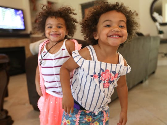 Twin 2-year-old sisters Leah, left, and Eva Joseph