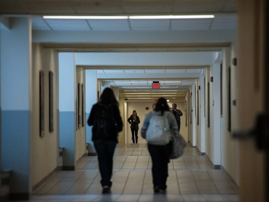 UW-Green Bay students walk through a tunnel connecting the David A. Cofrin Library with Mary Ann Cofrin Hall on campus on Jan. 30, 2014.