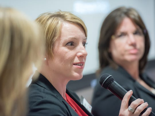 Katherine Carter, director of special projects for Dow Jones, responds to a question at  a women in technology panel at iCIMS in Old Bridge.