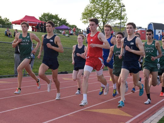 Runners round the first turn of the boys 166 M run. Eventual winner Drake Anzano of CBA is second from left. Day 1 of the Monmouth County Track and Field Championships was held at Holmdel High School, Holmdel, NJ on Wednesday. May 11, 2016. / Russ DeSantis for the Asbury Park Press / Slug:ASB 0512 Monmouth County Track