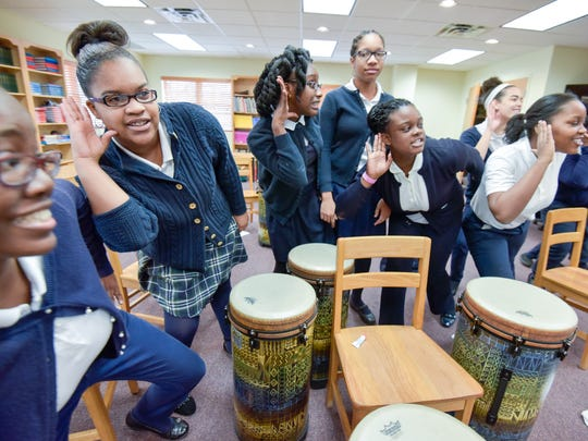 "The Sisters Academy of New Jersey, Asbury Park, has thrived with minority girls for decades. Music students perform ""The Light Comes Down."" /Russ DeSantis for the Asbury Park Press / Slug: Sisters Academy in Asbury Park"