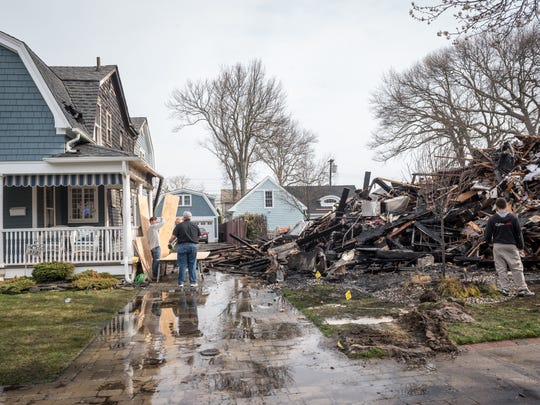 An early morning fire destroyed one home and badly