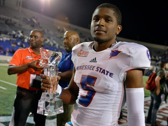 September 9, 2017 - Tennessee State University quarterback Treon Harris, 5, holds the MVP trophy after his team won the Southern Heritage Classic football game against Jackson State University at Liberty Bowl Memorial Stadium in Memphis, Tenn. (Brandon Dill/Special to The Commercial Appeal)