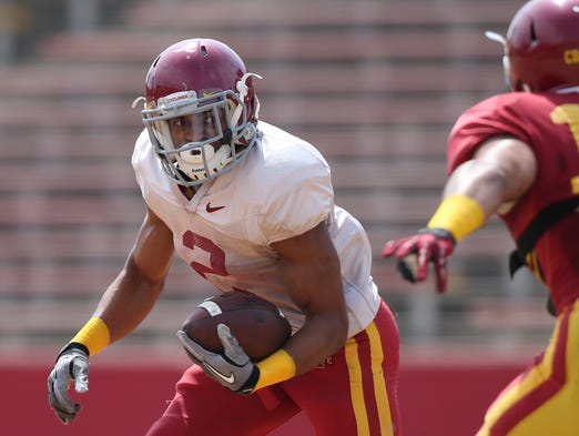 Iowa State tailback Aaron Wimberly carries the ball during the Iowa State football spring scrimmage on Saturday, April 12, 2014, at Jack Trice Stadium in Ames, Iowa.