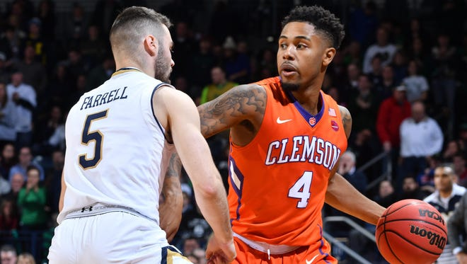 Clemson Tigers guard Shelton Mitchell (4) dribbles as Notre Dame Fighting Irish guard Matt Farrell (5) defends in the second half at the Purcell Pavilion. Notre Dame won 75-70.