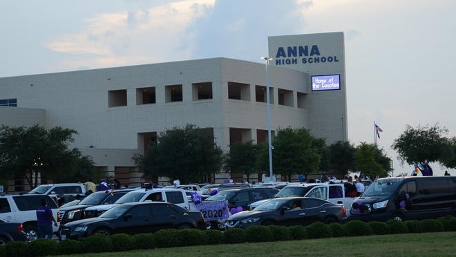 The parking lot at Anna High School is shown during graduation exercises earlier this  year. Anna ISD announced this week that instruction at all district campuses will begin Aug. 26.