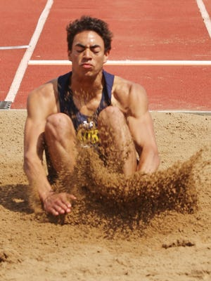 Ozaukee's Gavin Dorrier lands during the long jump during WIAA State Track finals Saturday June 3, 2017 in La Crosse, Wis.