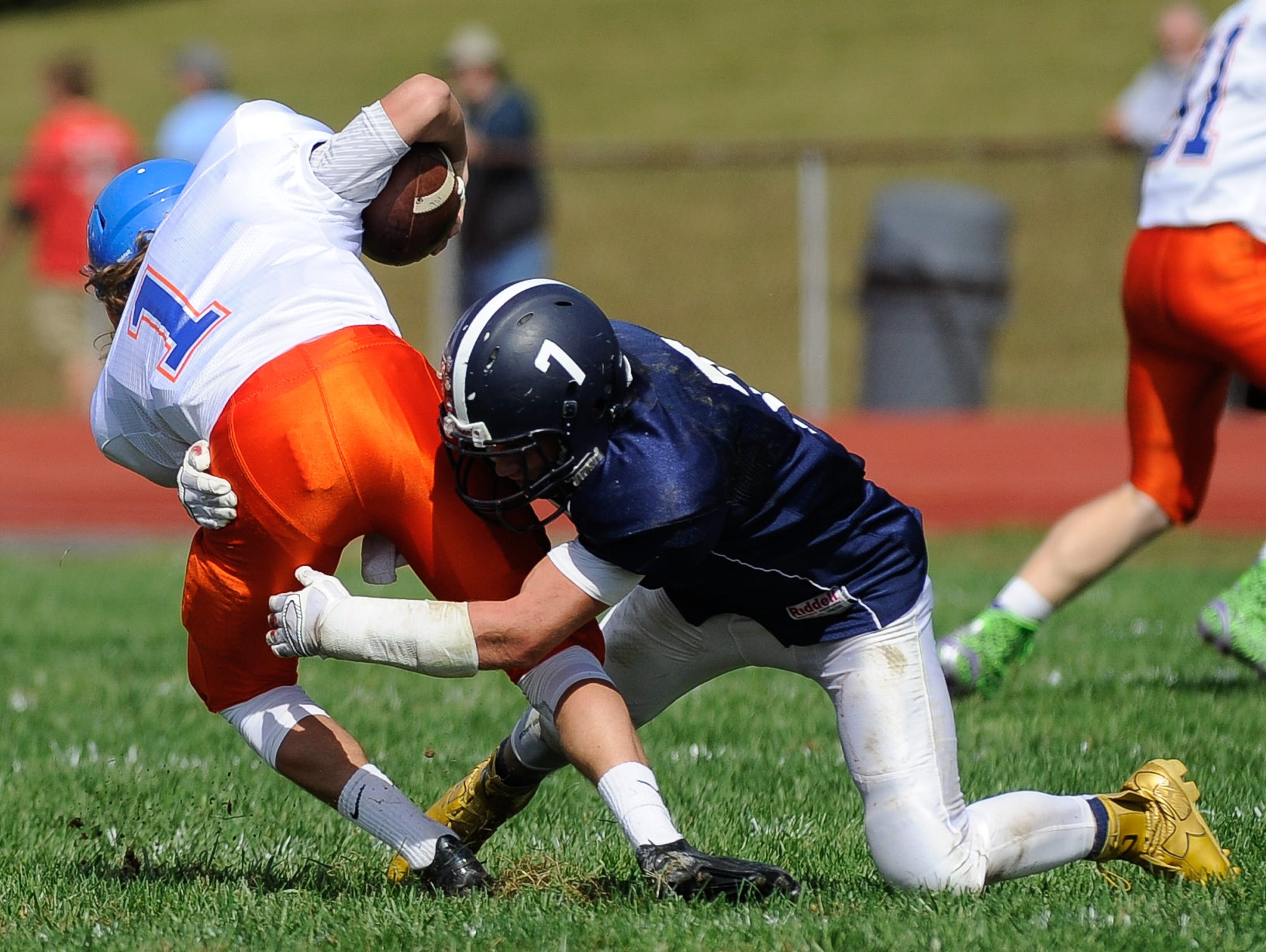 Lake Forest's #7 Ben Moore makes a tackle on Delmar's quarterback #1 James Adkins in their 19-14 win over Delmar on Saturday at Lake Forest High School.