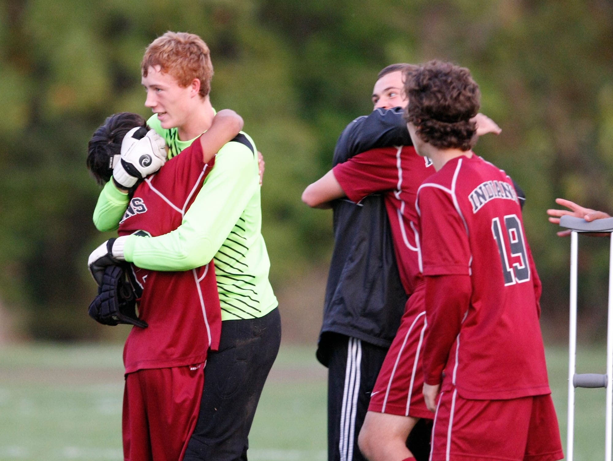 Nyack goalie Karl McGinnis, center, and Jose Gagliardi (13) celebrate their victory over Nanuet during a boys soccer game at Nanuet High School on Wednesday, Oct. 21, 2015.