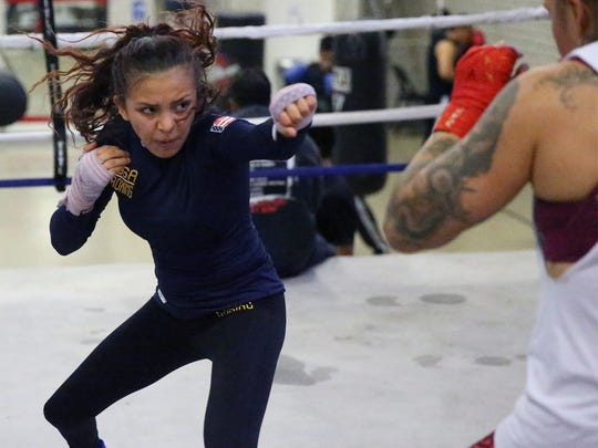 14-year-old boxer Kayla Gomez works out with her mother,