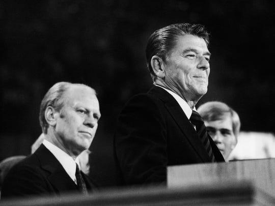 President Gerald Ford listens as Ronald Reagan addresses