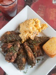 Jerk wings with a side of baked macaroni and cheese,