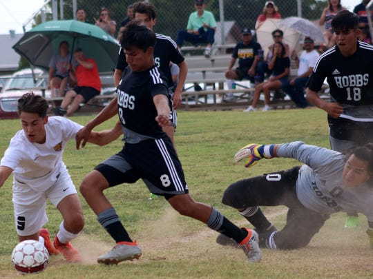 Hobbs' Giovanni Gonzalez tries to clear a ball out of the box Saturday afternoon.