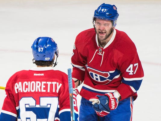 Montreal Canadiens' Max Pacioretty (67) celebrates with teammate Alexander Radulov after scoring against the Buffalo Sabres during second period NHL hockey action in Montreal, Tuesday, Jan. 31, 2017. (Graham Hughes/The Canadian Press via AP)