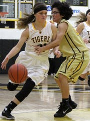 Calysta Jacob, left, drives past El Paso Austin's Bianca Morales on Monday night at the Tiger Pit.