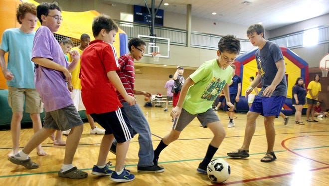 Matthew Eaton, 13, of West Memphis, Ark., dribbles during an indoor soccer game at Camp Bold in Olive Branch, Miss. The three-week camp is for youths with developmental disabilities. A new study finds that the percentage of children with disabilities rose 16% between 2001 and 2011.