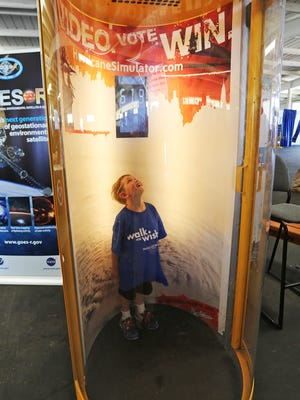 Isaiah Patterson, 6, of Denmark, marvels at the hurricane simulator in the Federal Pavilion during a special tour with other Make-A-Wish children at EAA AirVenture Saturday, July 30, 2016, at Oshkosh.