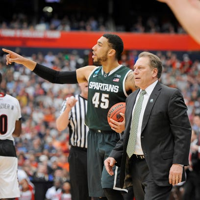 """Tom Izzo isn't embracing the """"underdog"""" label but, when he talked through the Final Four today at his news conference to preview it, he couldn't quite discard it. Pictured with player Denzel Valentine on the court against Louisville Sunday."""
