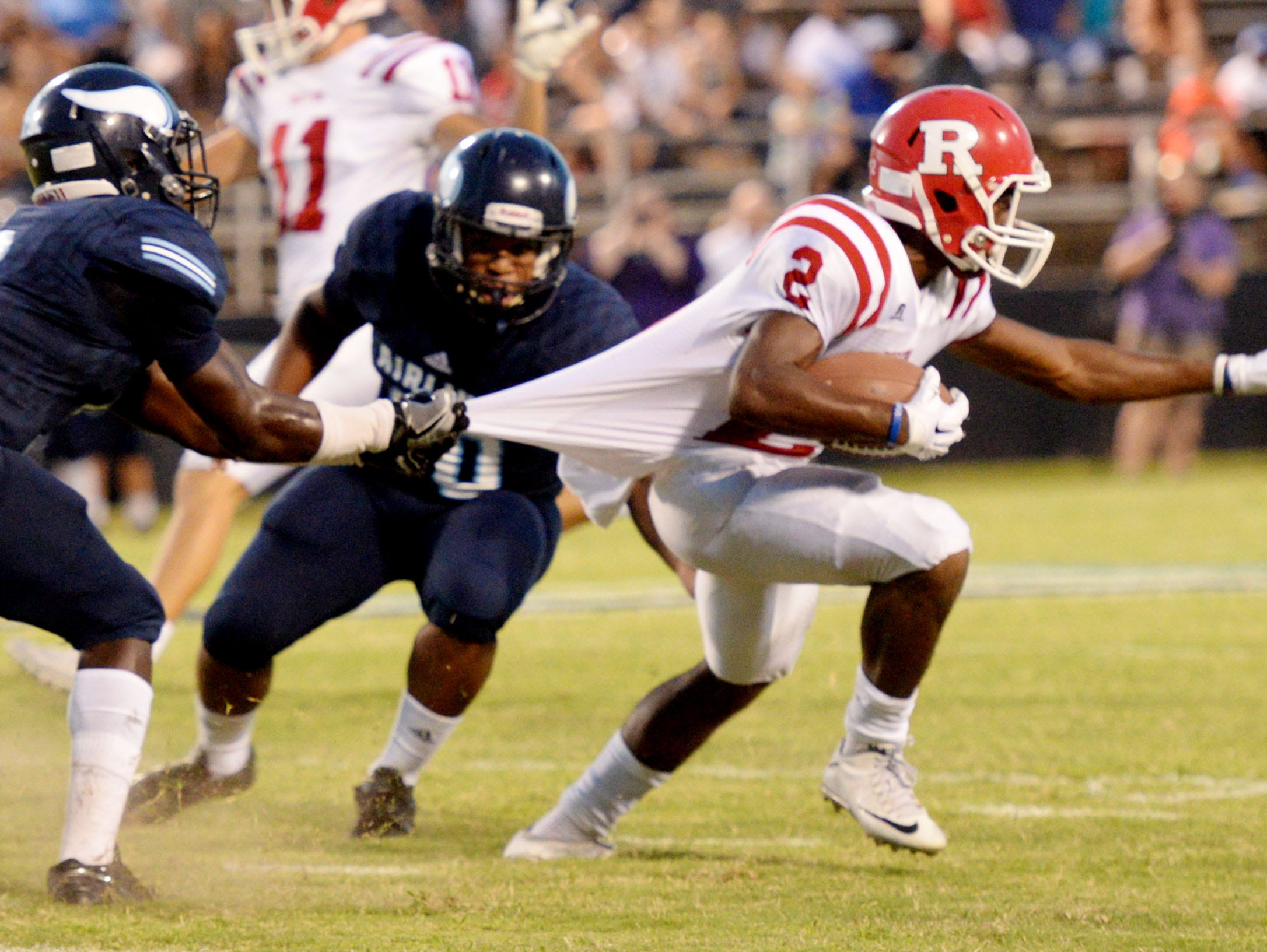 Ruston's Carlos Hunt tries to get past Airline's defense during their game Friday evening at Airline High School.