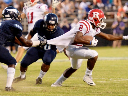 Ruston's Carlos Hunt tries to get past Airline's defense