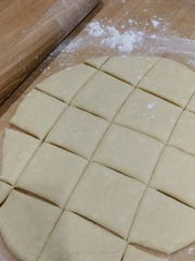 After rolling out dough for beignets, use a rolling