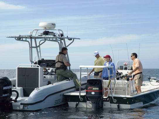 File: A Florida Fish and Wildlife Commission law enforcement