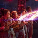 "From left, Melissa McCarthy, Kate McKinnon, Kristen Wiig and Leslie Jones in a scene from, ""Ghostbusters."""