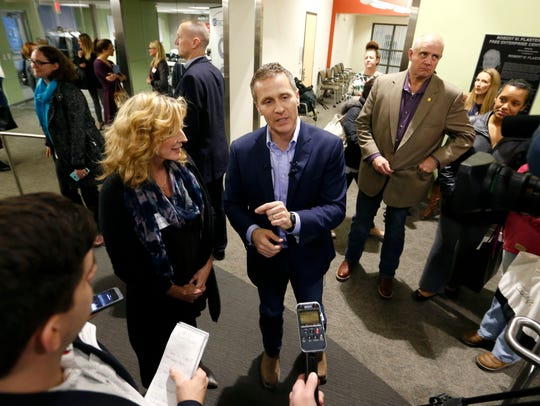 Former Treasurer Sarah Steelman stands next to Governor-elect