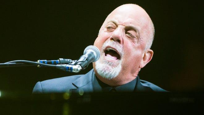 Billy Joel performs at US Airways Center in Phoenix June 1, 2014.
