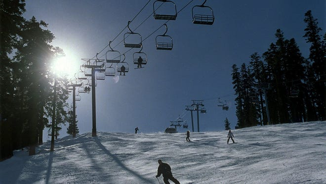 Skiers go under the lift at West Bowl at Sierra-at-Tahoe near Echo Summit.