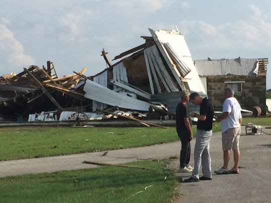 A pair of tornados touched down in Montgomery County, southeast of  Crawfordsville, flattening stalks of corn and damaging a shed, a barn and a cinder-block building belonging to Meredith Mangus. Mangus was not home at the time of the storms, and a friend said Mangus' farmhouse appeared undamaged by the storm.