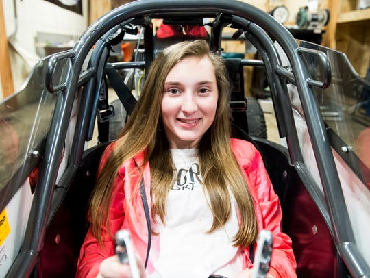 """Bailie Zepp, 14, sits in her junior dragster, """"Category"""