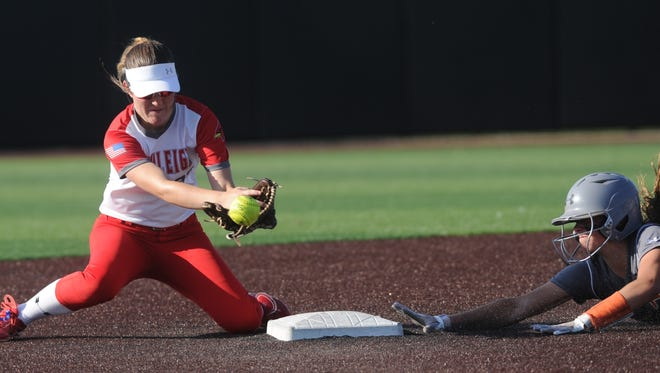 Rotan's Ryleigh Denton, right, slides into second with a double as Hermleigh second baseman Kami Smith fields the throw. Hermleigh beat the Lady Yellowhammers 17-8 in the one-game Region I-1A semifinal playoff game Saturday, May 12, 2018 at ACU's Wells Field.