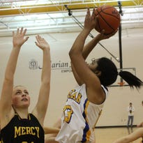 Guard Jaeda Robinson (right) is one of five seniors on the No. 1-ranked Marian basketball team.