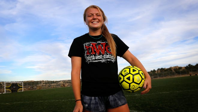 Aztec's Autumn Petersen poses for a portrait on Monday at the Aztec Tiger Sports Complex.