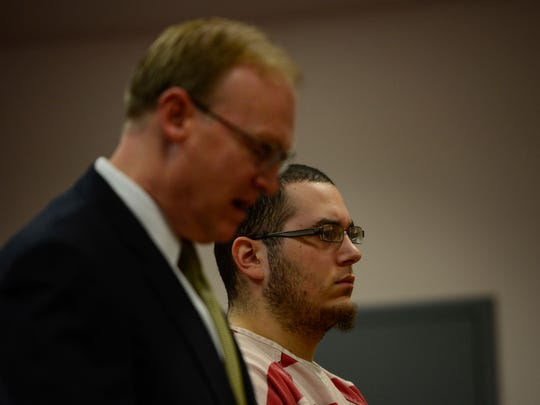 Julian Talamantez, 22, of Binghamton, (right) stands next to his lawyer, Michael Korchak, of Binghamton, (left) during Friday's sentencing in Broome County Court.
