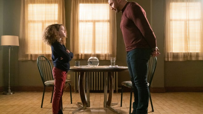 Sophie (Chloe Coleman) demands a spying lesson from JJ (Dave Bautista).