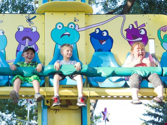 Kids take in rides during the Rock N' Ride on the first